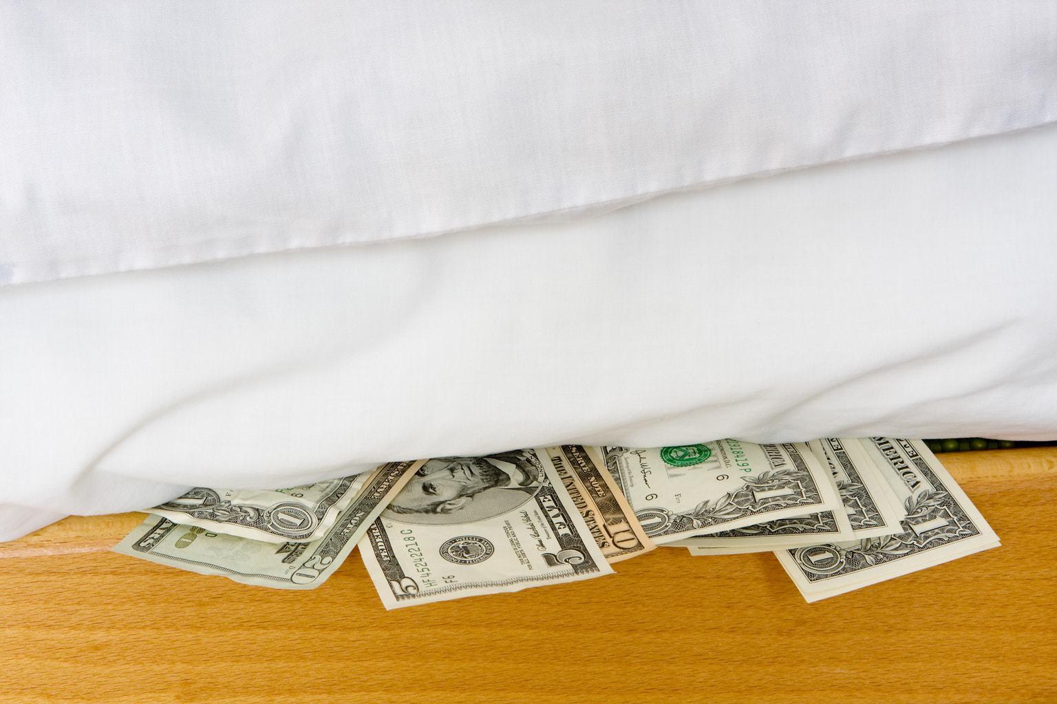 Money hidden under a white mattress