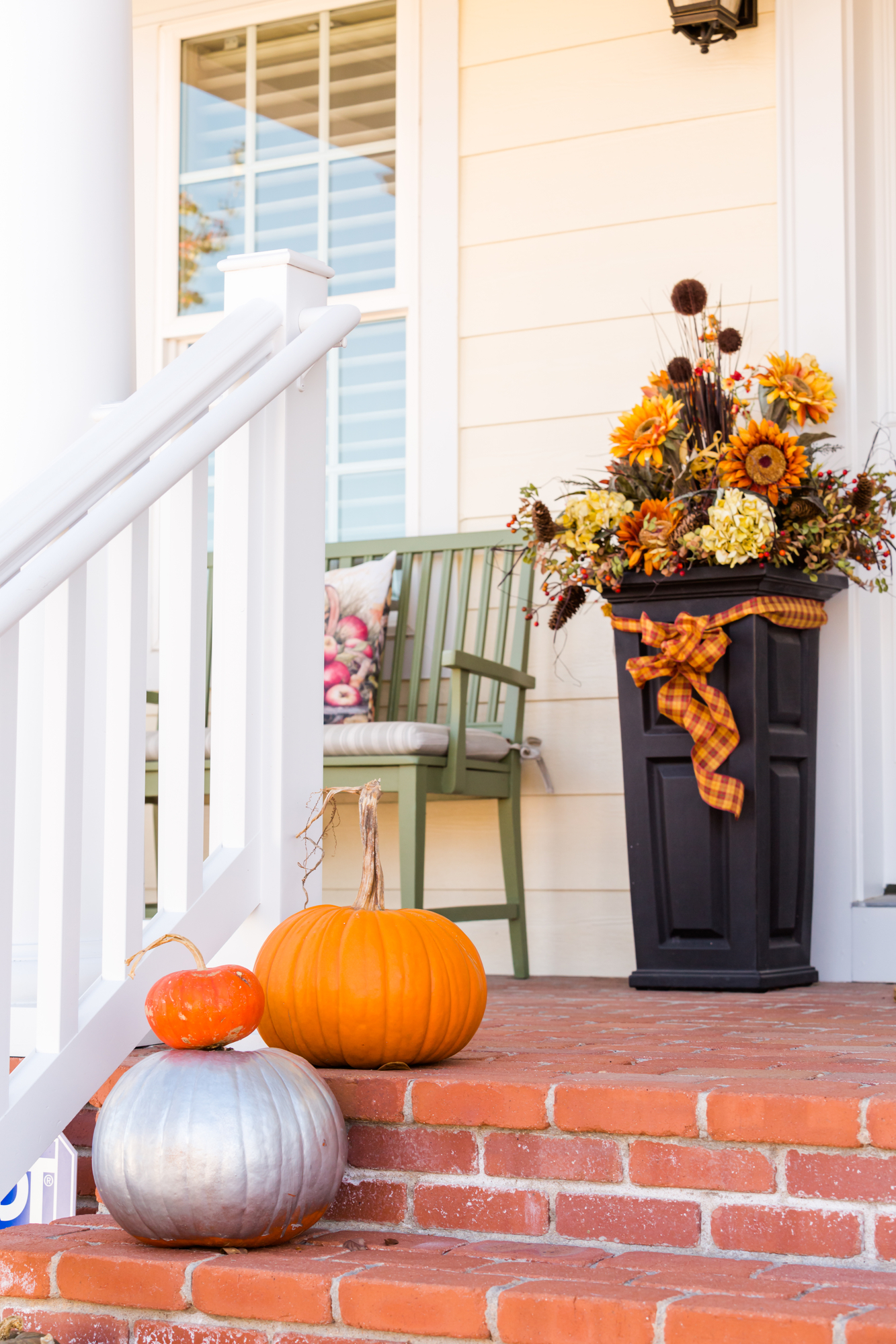 Fall Decor on Front Porch decorated for Halloween