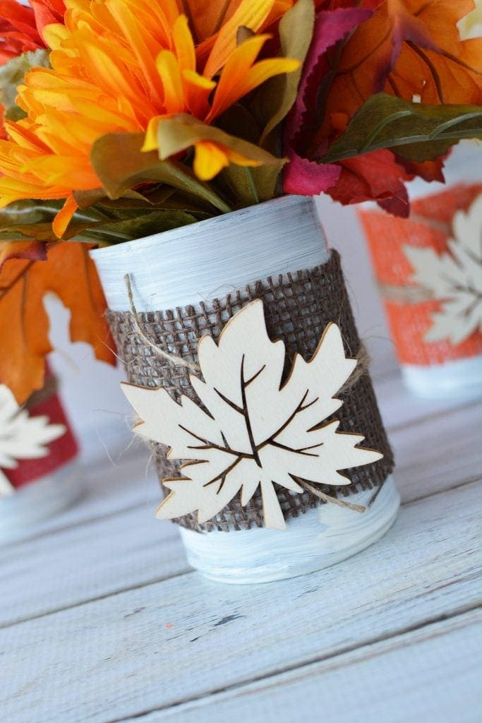 These Fall tin can centerpieces are an easy upcycle project that add a warm touch to your family's dinner table. Perfect for Thanksgiving too! #DIYFallCraft #FallCenterpieces