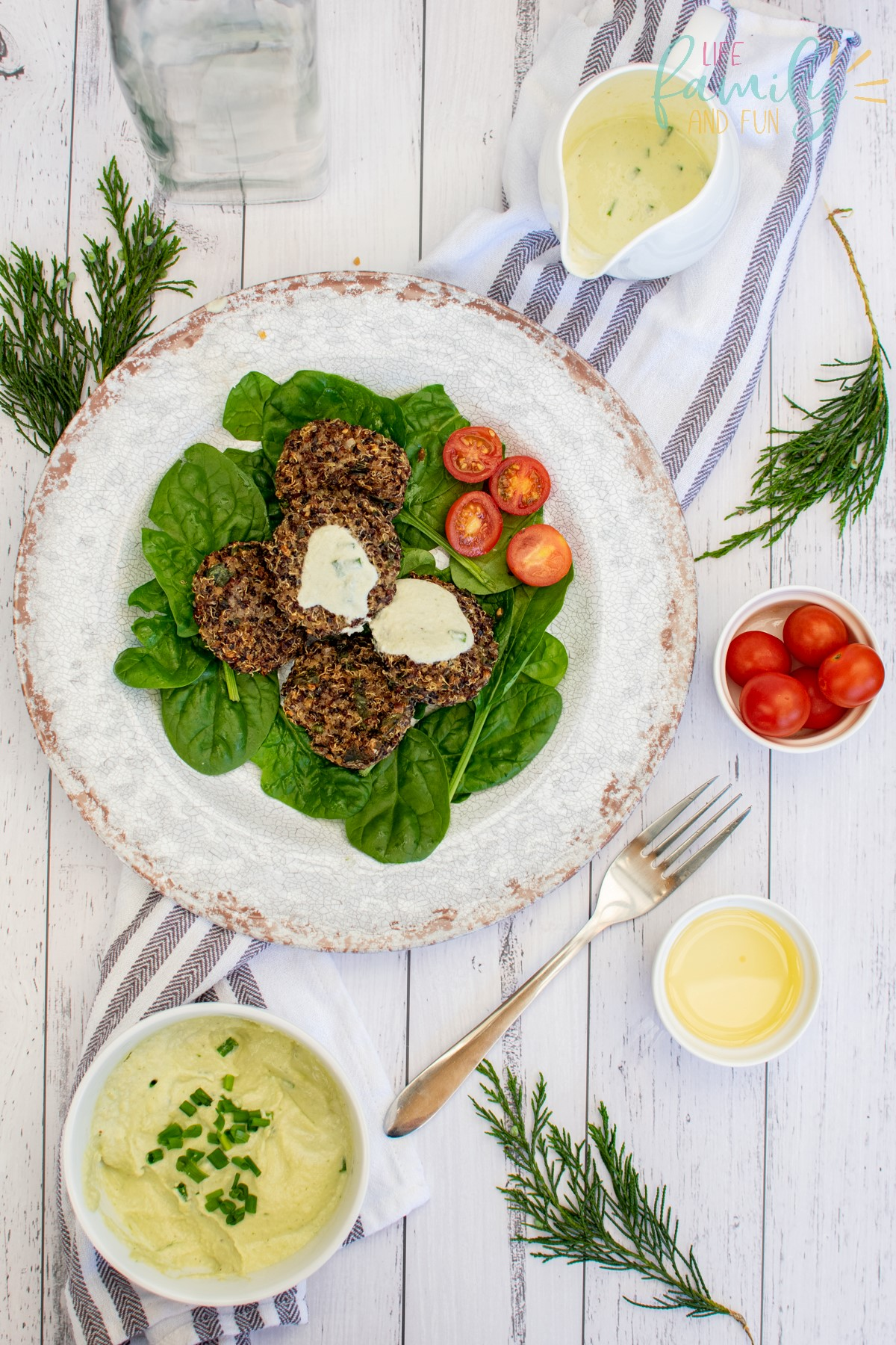 plated quinoa cakes with dressing